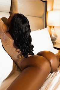 Curvy British black escort doing the splits